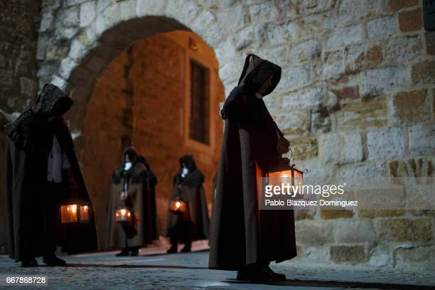 Penitents wearing brown capes from the Penitencia brotherhood take part in a procession on April 13 2017 in Zamora Spain Spain celebrates holy week...