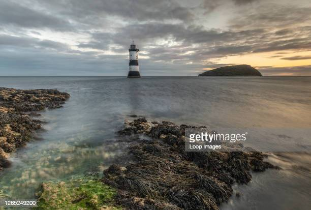 Penmon point lighthouse sunrise in Anglesey.