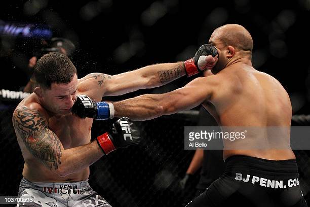 Penn and Frank Edgar both connect with punches during their UFC 118 lightweight title bout at the TD Garden on August 28, 2010 in Boston,...
