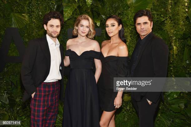 Penn Badgley, Elizabeth Lail, Shay Mitchell, and John Stamos attend the 2018 A+E Upfront on March 15, 2018 in New York City.