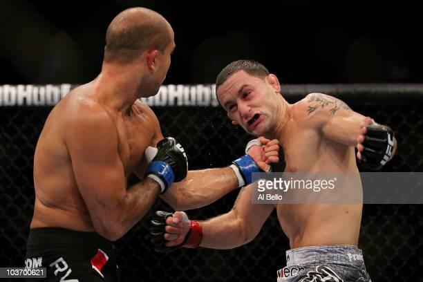 Penn connect with a punch to the face of Frank Edgar during their UFC 118 lightweight title bout at the TD Garden on August 28, 2010 in Boston,...