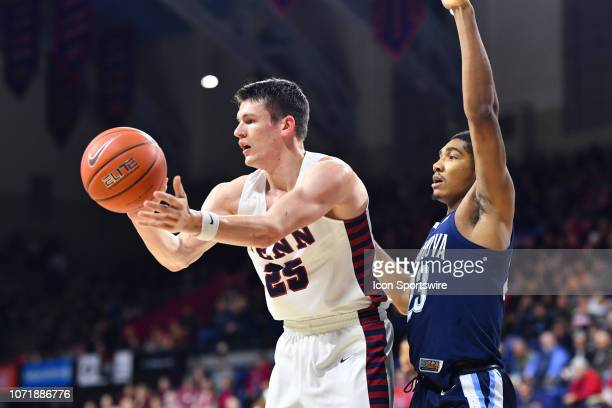 Penn Forward AJ Brodeur makes a pass guarded by Villanova Forward Jermaine Samuels in the first half during the game between the Penn Quakers and...