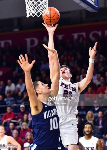 Penn Forward AJ Brodeur puts up a shot over Villanova Forward Cole Swider in the first half during the game between the Penn Quakers and Villanova...