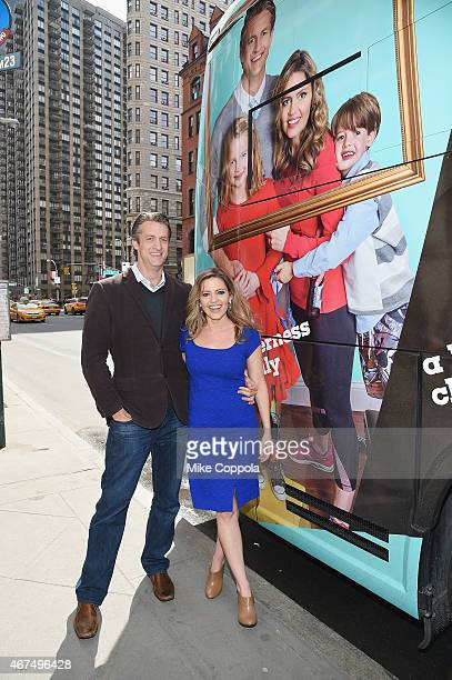 Penn Holderness and wife Kim Holderness pose for a picture at Up Tv's The Holderness Family Photo Call on March 25 2015 in New York City