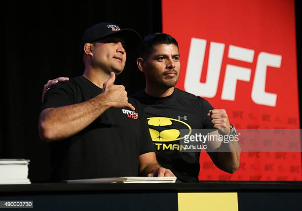 Penn interacts with a fan at the UFC Fan Expo in the Sands Expo and Convention Center on July 10, 2015 in Las Vegas Nevada.