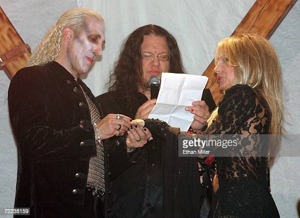 Penn Jillette of the comedy/magic duo Penn Teller officiates at the wedding vow renewal ceremony for Twisted Sister singer Dee Snider who puts a ring...