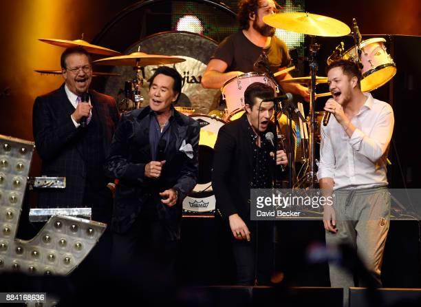 Penn Jillette of the comedy/magic team Penn Teller entertainer Wayne Newton singer Brandon Flowers of The Killers and frontman Dan Reynolds of...