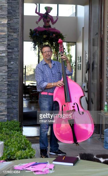 Penn Jillette of the comedy/magic team Penn Teller plays a double bass as he waits to be photographed by photographer Jerry Metellus as part of his...