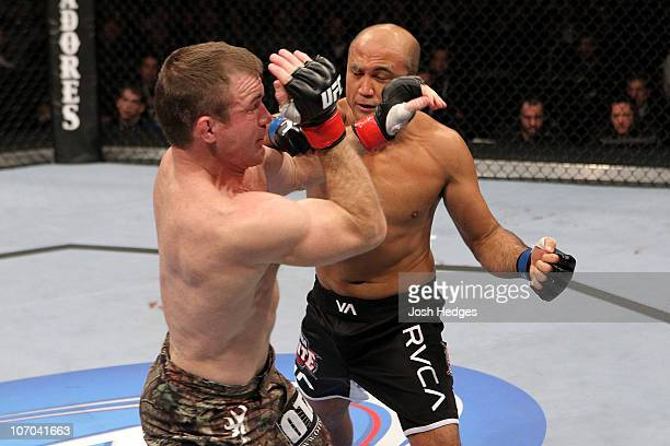 Penn knocks down Matt Hughes in the first round during their Welterweight bout part of UFC 123 at the Palace of Auburn Hills on November 20, 2010 in...