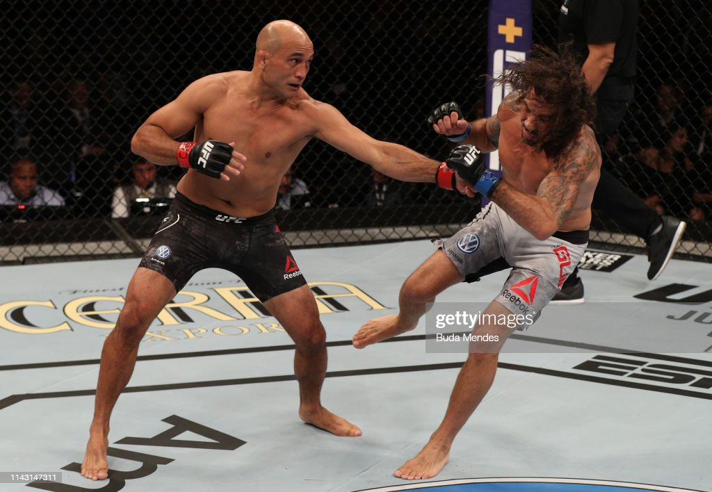 BJ Penn punches Clay Guida in their lightweight bout during