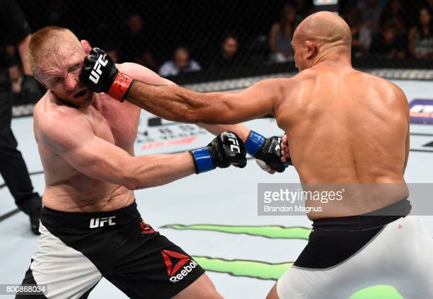 BJ Penn punches Dennis Siver of Germany in their featherweight bout during the UFC Fight Night event at the Chesapeake Energy Arena on June 25 2017...