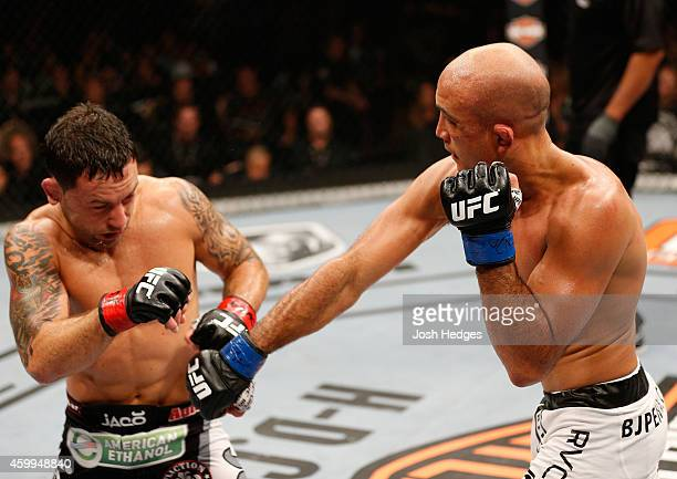 Penn punches Frankie Edgar in their featherweight fight during The Ultimate Fighter Finale event at the Mandalay Bay Events Center on July 6, 2014 in...