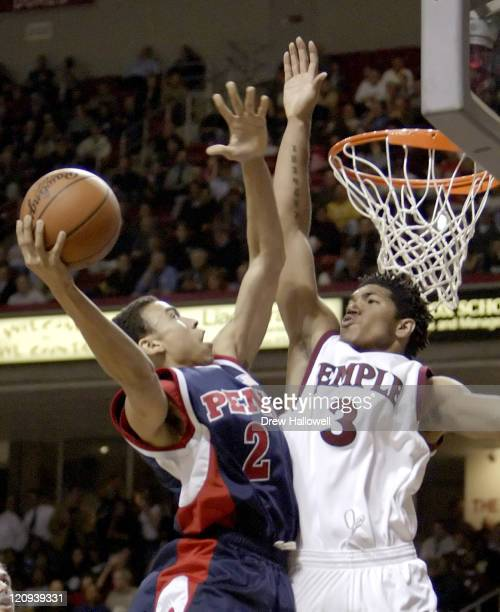 Penn Quaker Ibrahim Jaaber goes up for a shot while Temple Owls Dustin Salisbery attempts to block the shot. University of Pennsylvania Quakers were...