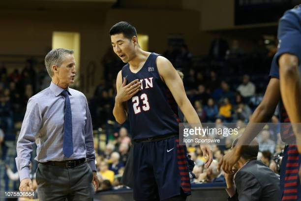 Penn Quakers forward Michael Wang talks to Penn Quakers head coach Steve Donahue during a regular season nonconference game between the Penn Quakers...