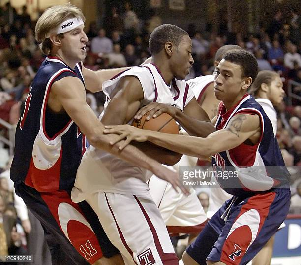 Penn Quakers Jan Fikiel and Jaaber Ibrahim try to steal the ball from Temple Owls Antyane Robinson. University of Pennsylvania Quakers were defeated...