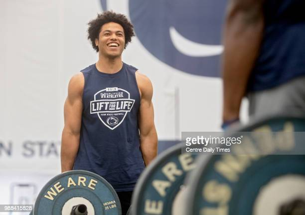 Penn State cornerback John Reid laughs as he competes in the farmers hold against Amani Oruwariye during the annual Lift For Life at Holuba Hall in...