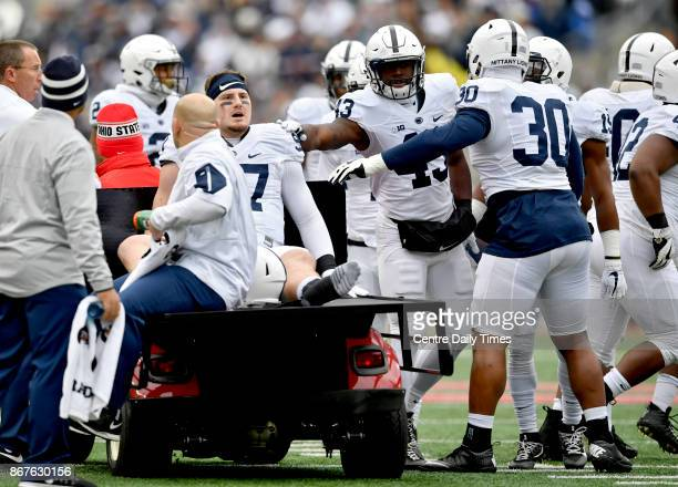 Penn State defensive end Ryan Buchholz is encouraged by teammates as he is carted off the field in the first quarter against Ohio State on Saturday...