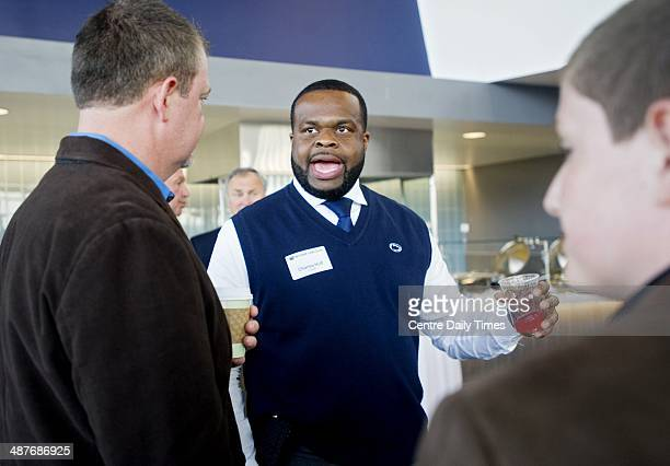 Penn State football running backs coach Charles Huff chats with alumni and fans during the Coaches Caravan at Pegula Ice Arena in State College Pa...