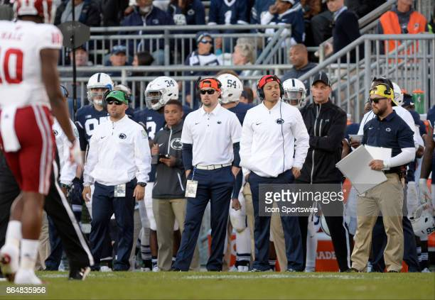 Penn State graduate assistant coaches signal in plays or defenses or calss from the side line wearing different colored hats and head sets The Penn...