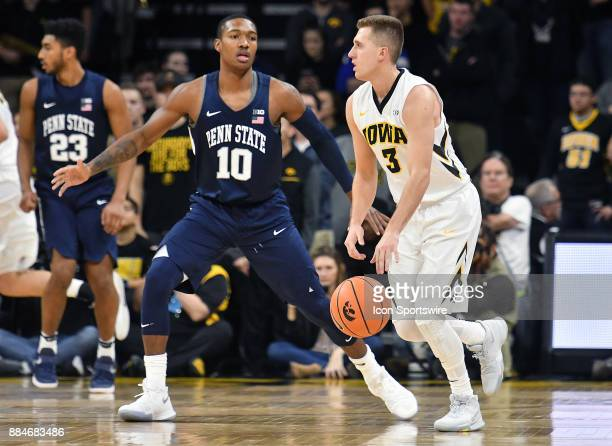 Penn State guard Tony Carr guards Iowa guard Jordan Bohannon as he looks to pass the ball during a Big Ten Conference basketball game between the...