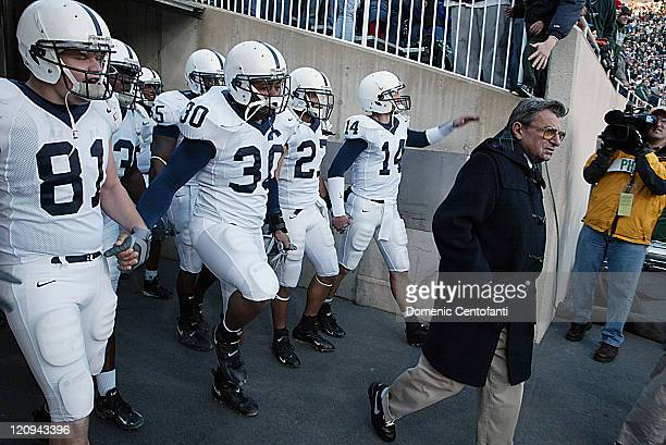 Penn State head coach Joe Paterno leads his team onto the field in East Lansing. Penn State won its second Big Ten title with a 31-22 victory over...