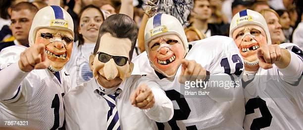 Penn State Nittany Lions fans dressed as head coach Joe Paterno and players cheer against the Texas AM Aggies during the Valero Alamo Bowl on...