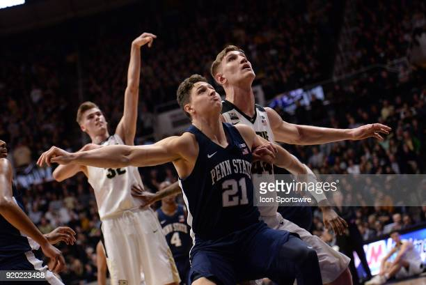 Penn State Nittany Lions Forward John Harrar boxes out Purdue Boilermakers center Isaac Haas as Purdue Boilermakers forward Matt Haarms shoots a free...