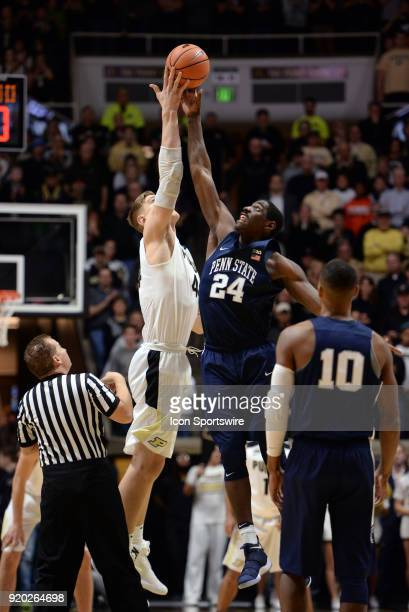 Penn State Nittany Lions Forward Mike Watkins and Purdue Boilermakers center Isaac Haas go up for the opening tip during the Big Ten Conference...