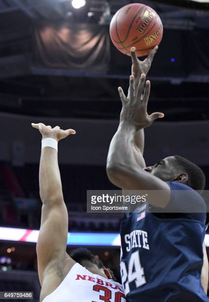 Penn State Nittany Lions forward Mike Watkins scores in the first half against Nebraska Cornhuskers forward Ed Morrow in the first round of the Big...