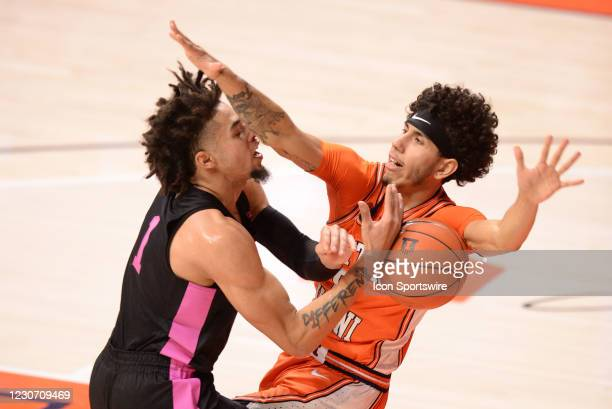 Penn State Nittany Lions forward Seth Lundy is called for an offensive foul as he collided with Illinois Fighting Illini guard Andre Curbelo during...