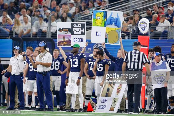 Penn State Nittany Lions gives signals by holding signs during the Cotton Bowl Classic between the Memphis Tigers and Penn State Nittany Lions on...