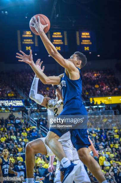 Penn State Nittany Lions guard Myreon Jones goes in for a layup during the Michigan Wolverines game versus the Penn State Nittany Lions on Thursday...