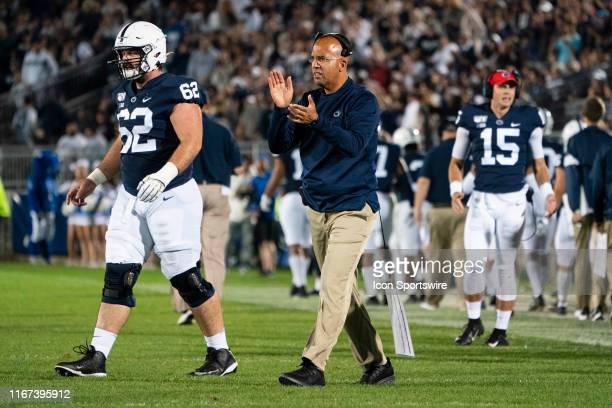 Penn State Nittany Lions Head Coach James Franklin claps for his players after they scored a touchdown during the second half of the game between the...