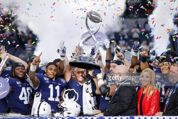 Penn State Nittany Lions head coach James Franklin holds the trophy after winning the Cotton Bowl Classic between the Memphis Tigers and Penn State...