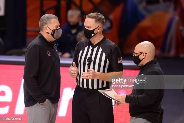 Penn State Nittany Lions interim head coach Jim Ferry talks with Big Ten referee Paul Szelc and Penn State Nittany Lions associate head coach Keith...