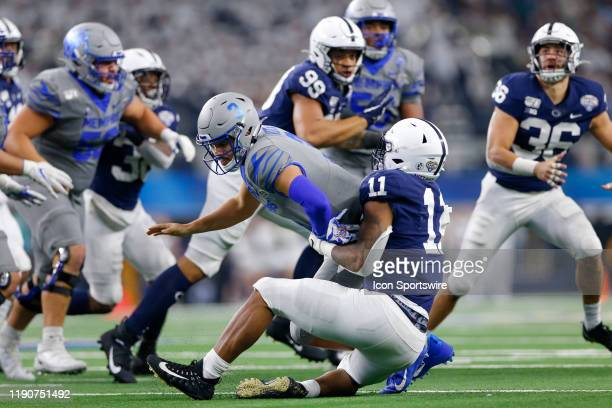 Penn State Nittany Lions linebacker Micah Parsons strips the ball from Memphis Tigers quarterback Brady White that results in an interception...