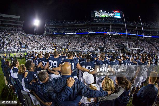 Penn State Nittany Lions players and fans sing to celebrate the team's win over Iowa Hawkeyes on November 5 2016 at Beaver Stadium in State College...