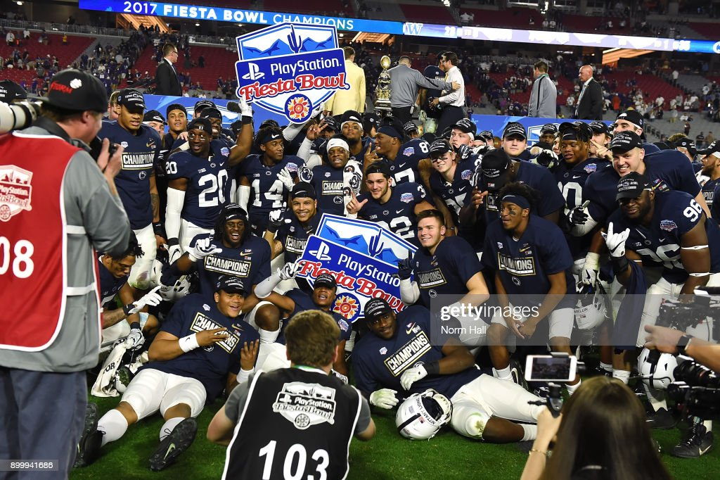Penn State Nittany Lions players pose for a photo after beating the Washington Huskies 35-28 during the Playstation Fiesta Bowl at University of Phoenix Stadium on December 30, 2017 in Glendale, Arizona.