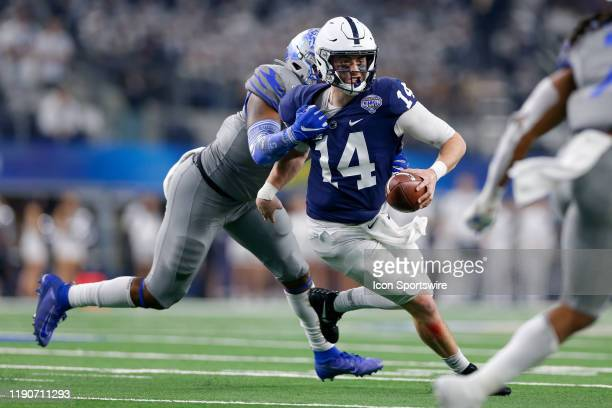 Penn State Nittany Lions quarterback Sean Clifford is tackled by Memphis Tigers defensive end Everitt Cunningham during the Cotton Bowl Classic...