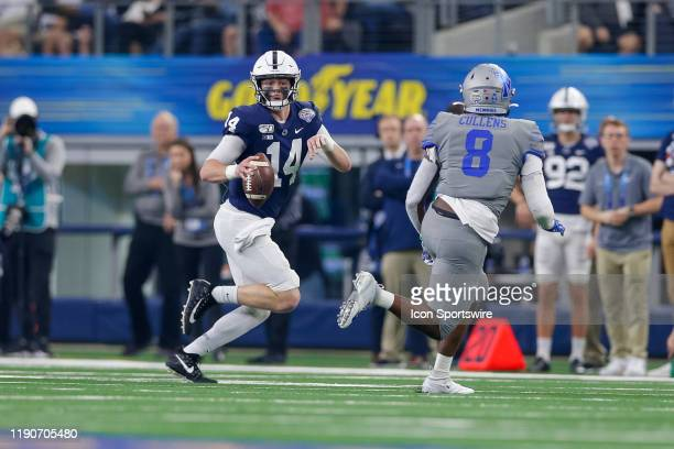 Penn State Nittany Lions quarterback Sean Clifford rolls out for a pass during the Cotton Bowl Classic between the Memphis Tigers and Penn State...