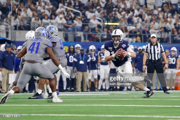 Penn State Nittany Lions quarterback Sean Clifford runs a sneak during the Cotton Bowl Classic between the Memphis Tigers and Penn State Nittany...