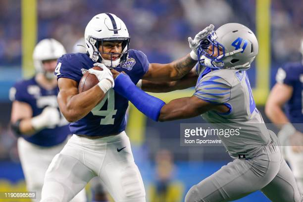 Penn State Nittany Lions running back Journey Brown breaks through a tackle attempt by Memphis Tigers defensive back Sanchez Blake Jr. And runs for a...