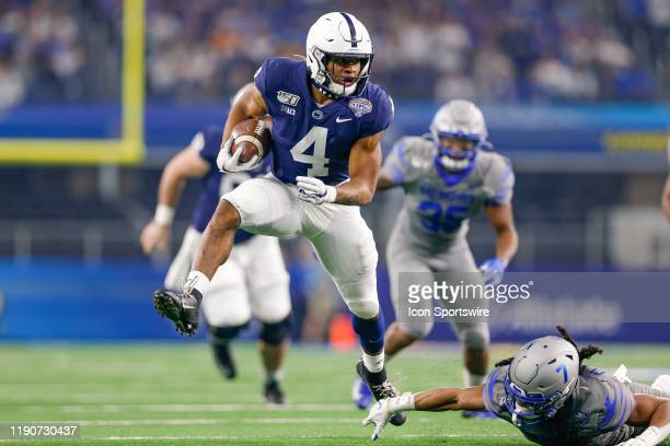 Penn State Nittany Lions running back Journey Brown breaks through a tackle by Memphis Tigers defensive back Chris Claybrooks and runs for a...