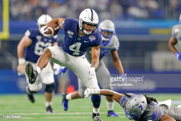 Penn State Nittany Lions running back Journey Brown breaks through a tackle attempt by Memphis Tigers defensive back Chris Claybrooks and scores a...