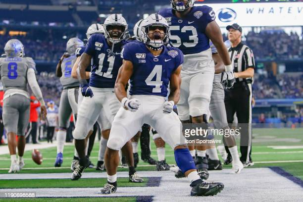 Penn State Nittany Lions running back Journey Brown celebrates his 32 yard touchdown rush during the Cotton Bowl Classic between the Memphis Tigers...