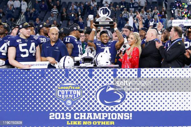 Penn State Nittany Lions running back Journey Brown holds the Sanford trophy after winning the Cotton Bowl Classic between the Memphis Tigers and...