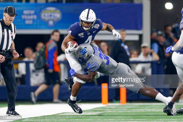 Penn State Nittany Lions running back Journey Brown is hit by Memphis Tigers defensive back Jacobi Francis during the Cotton Bowl Classic between the...