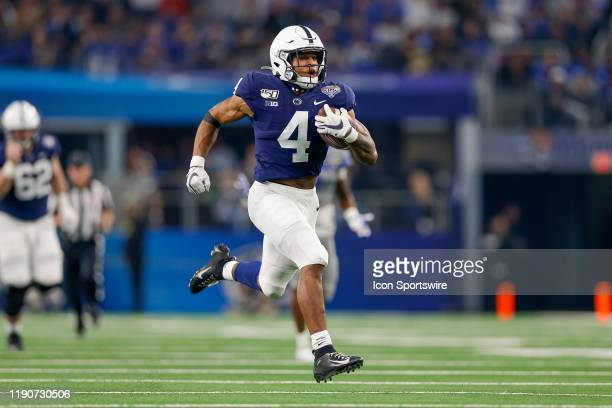 Penn State Nittany Lions running back Journey Brown rushes for a long touchdown zduring the Cotton Bowl Classic between the Memphis Tigers and Penn...