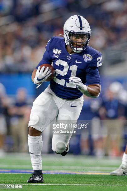 Penn State Nittany Lions running back Noah Cain rushes during the Cotton Bowl Classic between the Memphis Tigers and Penn State Nittany Lions on...