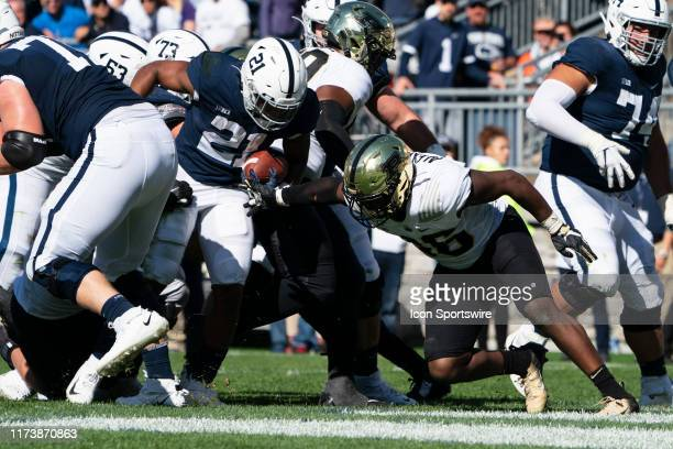 Penn State Nittany Lions Runnning Back Noah Cain runs the ball in for a touchdown with Purdue Boilermakers Linebacker Jaylan Alexander defending...